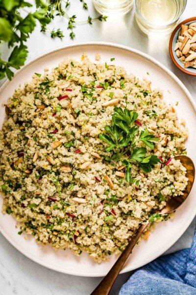 A plate of herbed lemon quinoa garnished with parsley