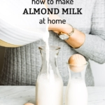A woman is pouring almond milk into a jar