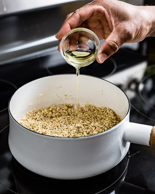 Adding oil to create a flavored and seasoned recipe