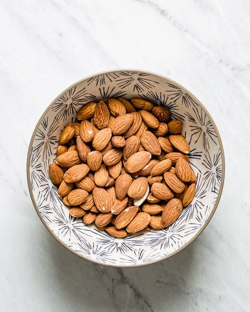 Raw unsalted almonds in a bowl