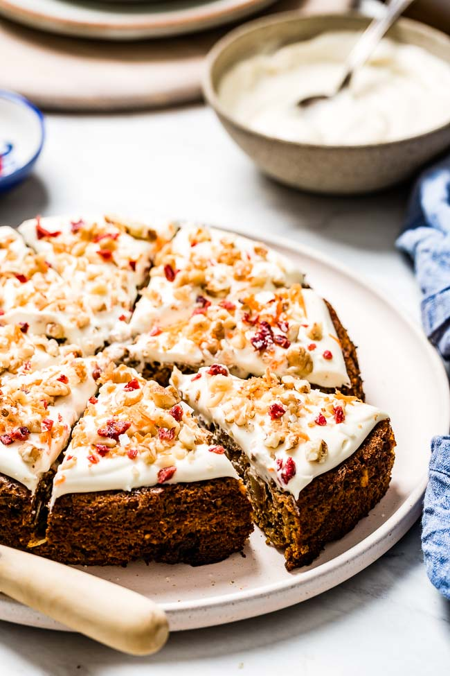A whole paleo carrot cake with almond flour is photographed from the front view