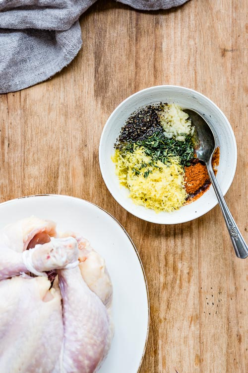 easy roast chicken seasoning ingredients all placed in a bowl