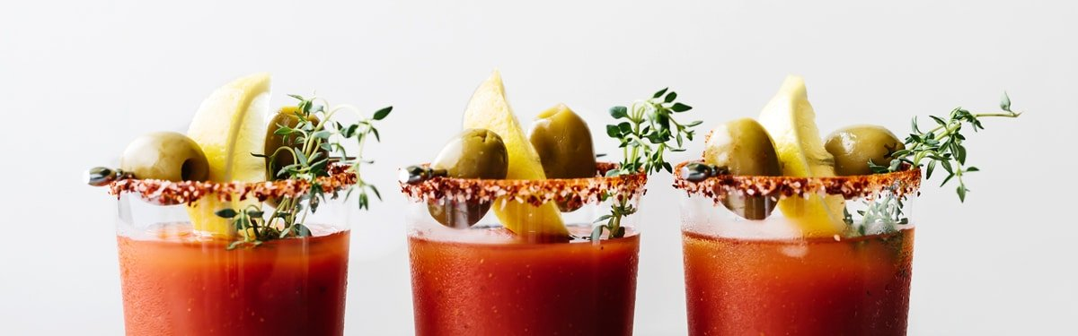 Easy Drink Recipes - Bloody Mary filled glasses garnished with olives and lemon