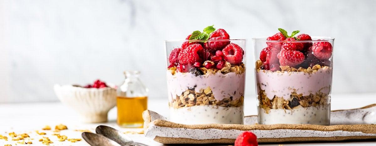 two bowls of yogurt parfait with raspberries