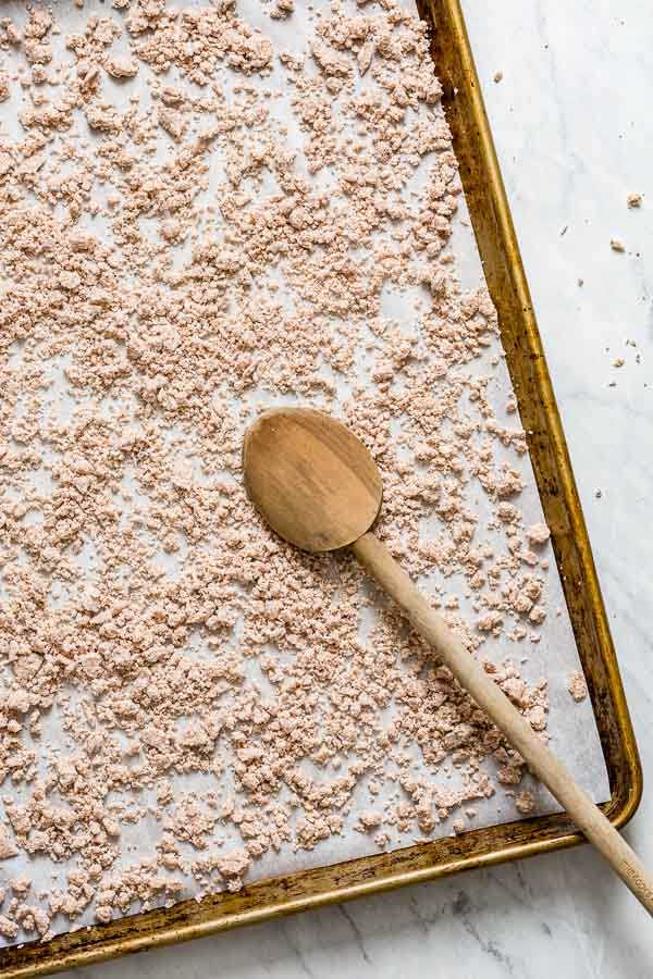 Dry nut flour spread on a baking sheet