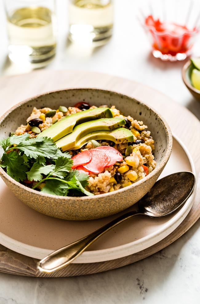 Mexican quinoa bowl with a spoon on the side