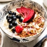 Instant Quinoa Breakfast topped off with nuts, granola and fruit.