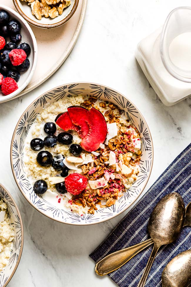 Make ahead breakfast bowls topped off with fruit served with milk on the side
