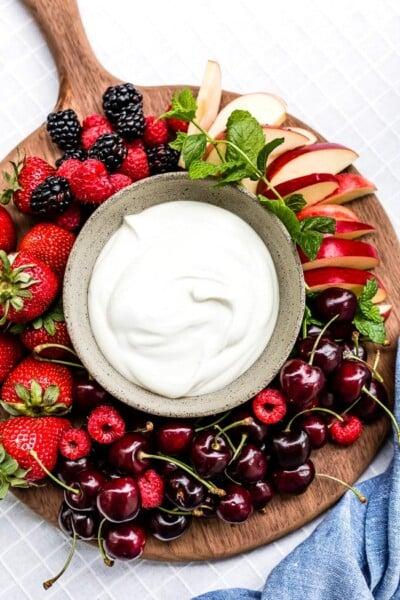 Yogurt Fruit Dip in a bowl served with various summer fruit.