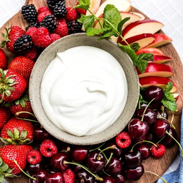 Yogurt Fruit Dip in a bowl served with various summer fruit.