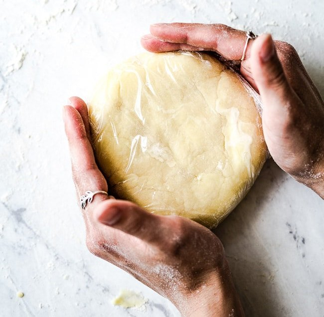 person shaping the galette dough