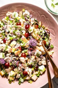 Greek Yogurt Chicken salad with apples, grapes, and avocados photographed from the top view