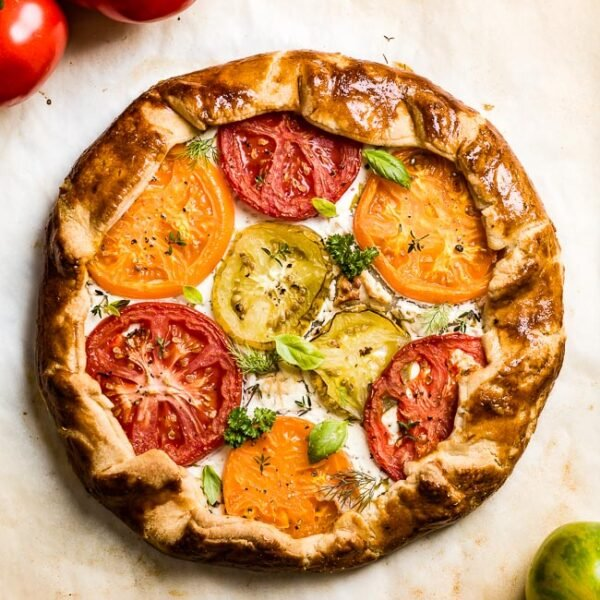 Tomato Galette from the top view right out of the oven with tomatoes on top