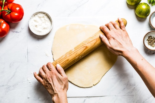 A woman rolling out the galette dough