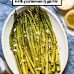 Baked asparagus on a plate with text on the image