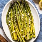 Baked Asparagus Recipe right out of the oven on an oval plate from the top view