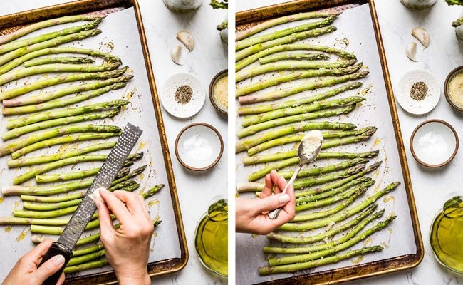 Person adding garlic and parmesan cheese to asparagus on a sheet pan