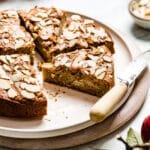 Almond Flour Apple Cake sliced with a knife on the side