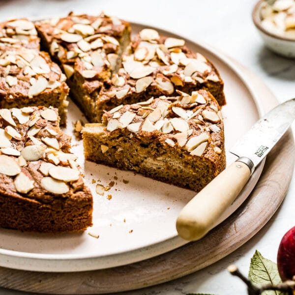 Almond Flour Apple Cake sliced with a knife on the side