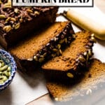 Paleo Pumpkin Bread with almond flour is sliced on a cutting board