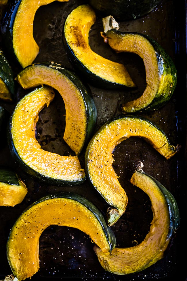 Japanese squash slice getting roasted on a sheet pan