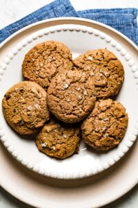 Almond Flour Peanut Butter Cookies are placed on a plate on top of each other