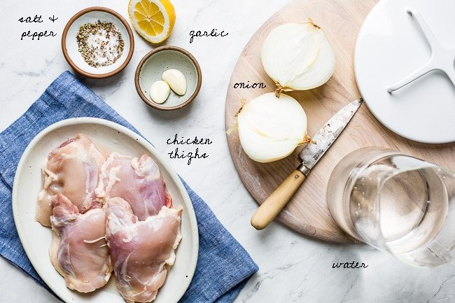 Ingredients for chicken plov laid out on a marble counter