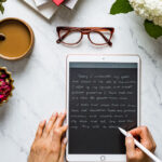 foolproof life lately december 2020 - Person writing on an ipad top view