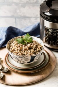 Quinoa Cooked in a rice cooker in a bowl garnished with parsley