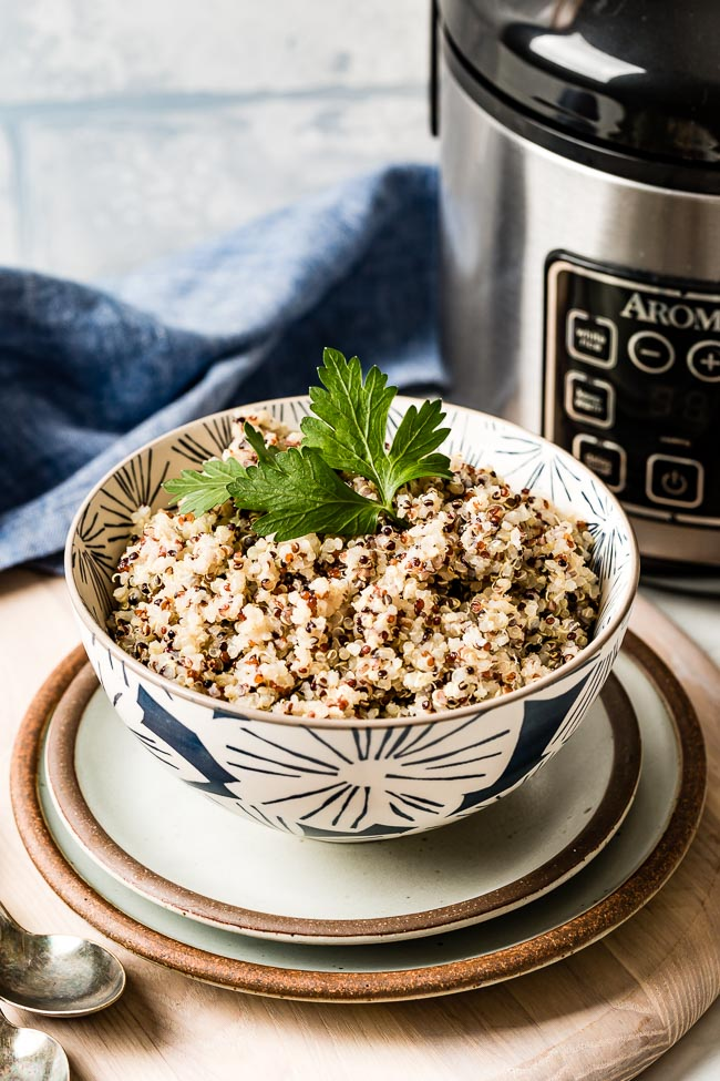 Quinoa in Cooked in rice cooker in a bowl garnished with parsley