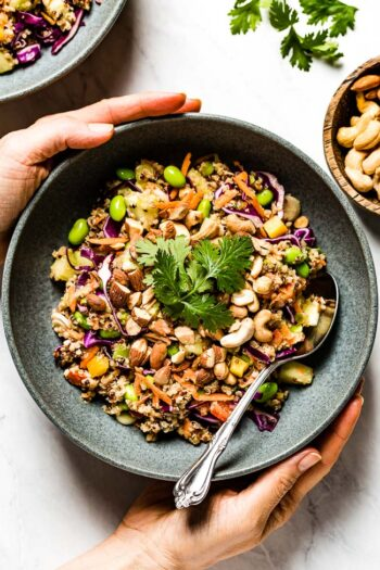 Thai Quinoa Salad in a bowl being served by a person