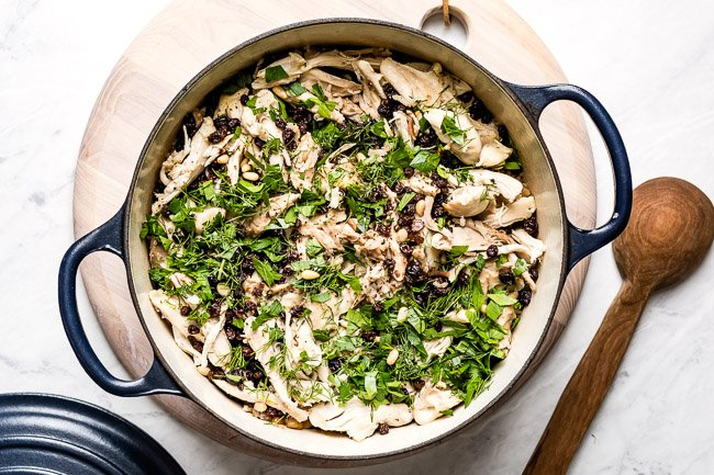 Easy rice pilaf with chicken in a dutch oven from the top view.