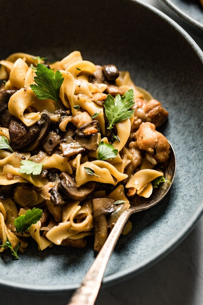 Chicken Mushroom Stroganoff allrecipes served in a bowl with a spoon on the side