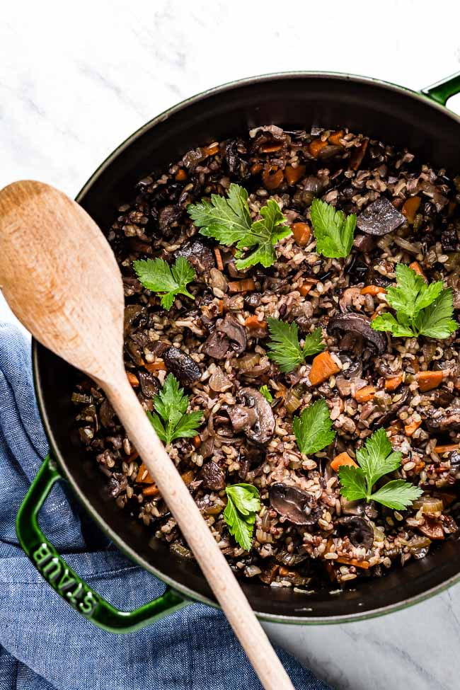 Wild Rice Pilaf in a pot with a wooden spoon on the side