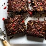 Almond flour brownies sliced with a knife on the side