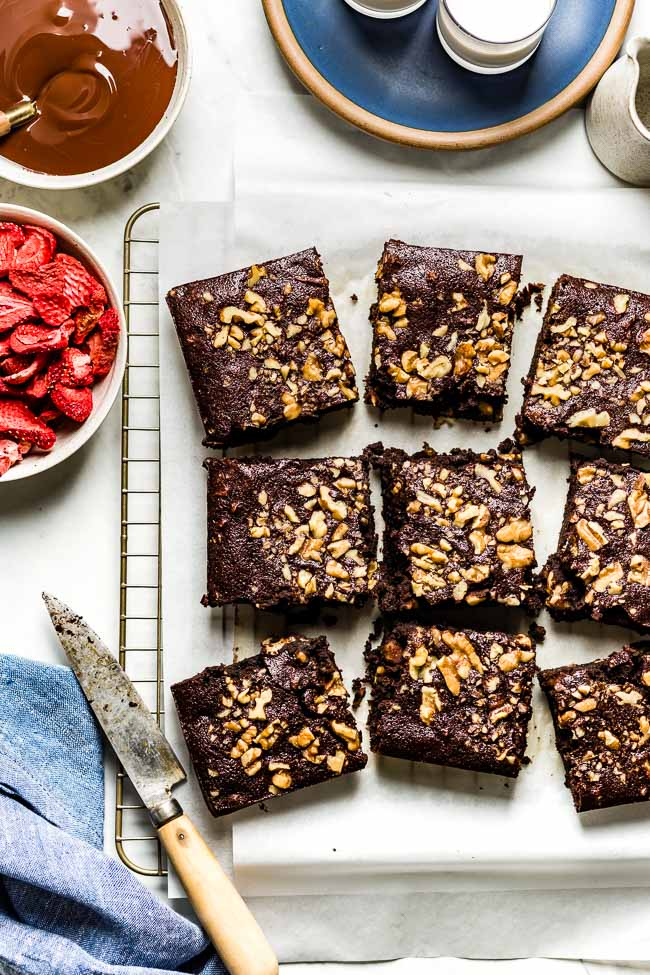Paleo Chocolate brownies cut into squares with a knife on the side