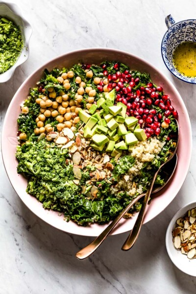 Kale Quinoa Salad in a bowl with spoons on the side