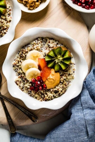 Quinoa porridge topped off with fruit in a bowl