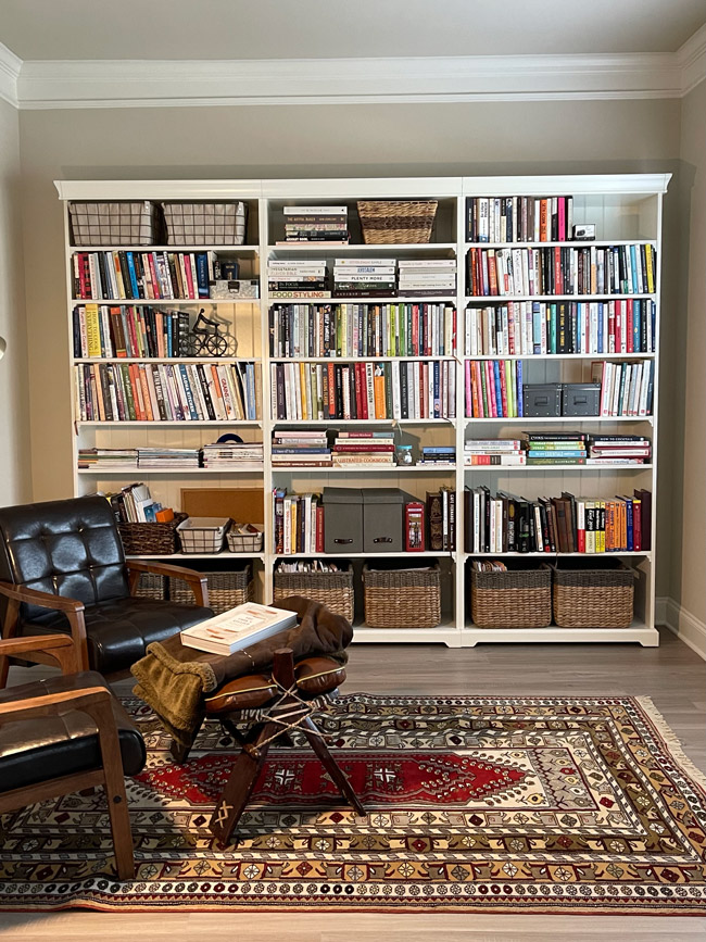 Reading room with bookshelves and a couch