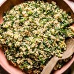 Tabbouleh Salad in a bowl with a wooden spoon on the side top view