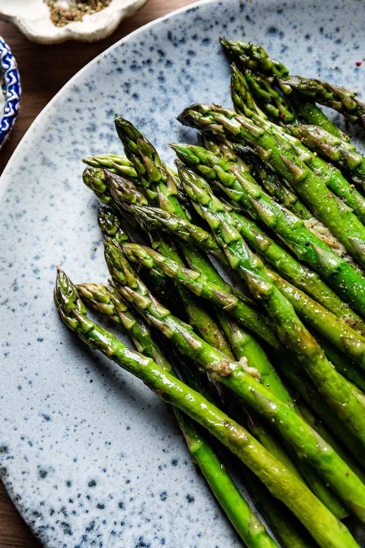 Garlic Butter Asparagus on a plate close up