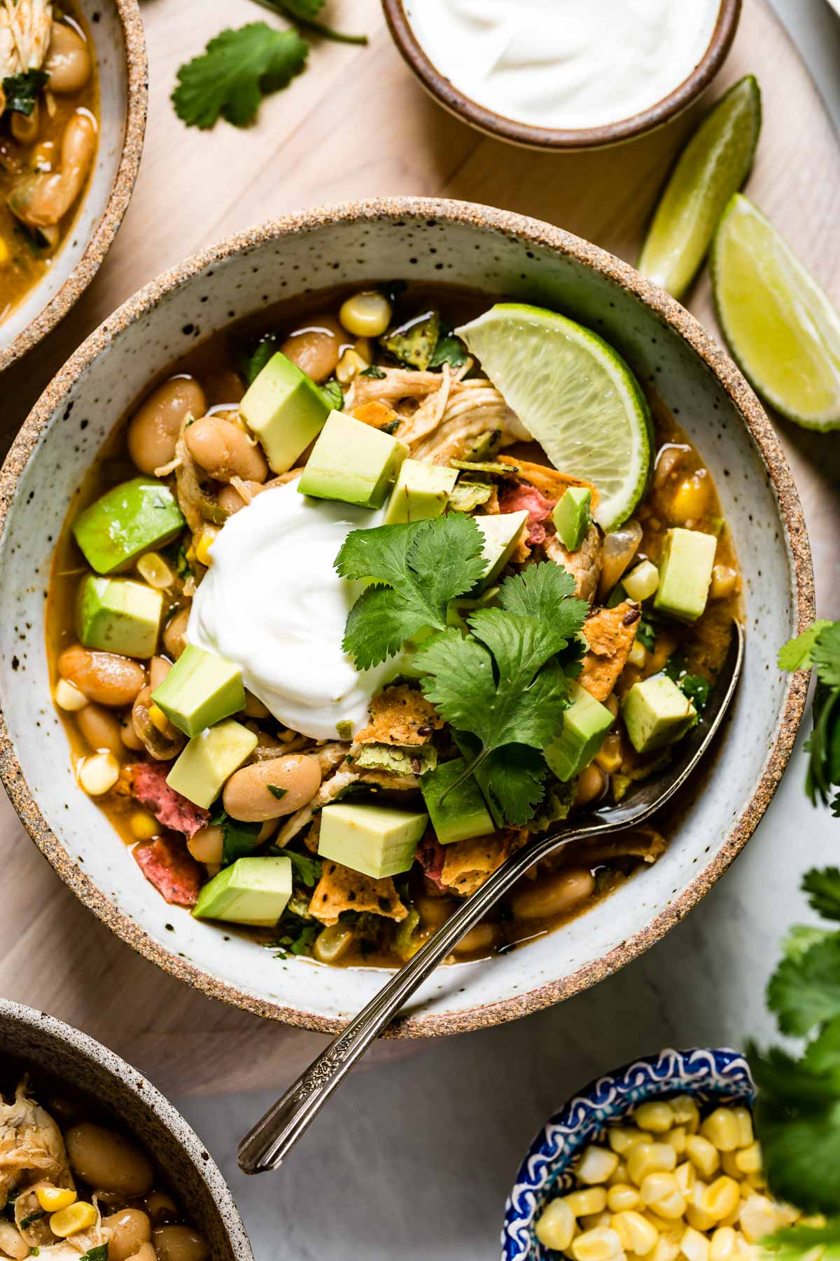 Instant Pot white bean chicken chili in a bowl with toppings.