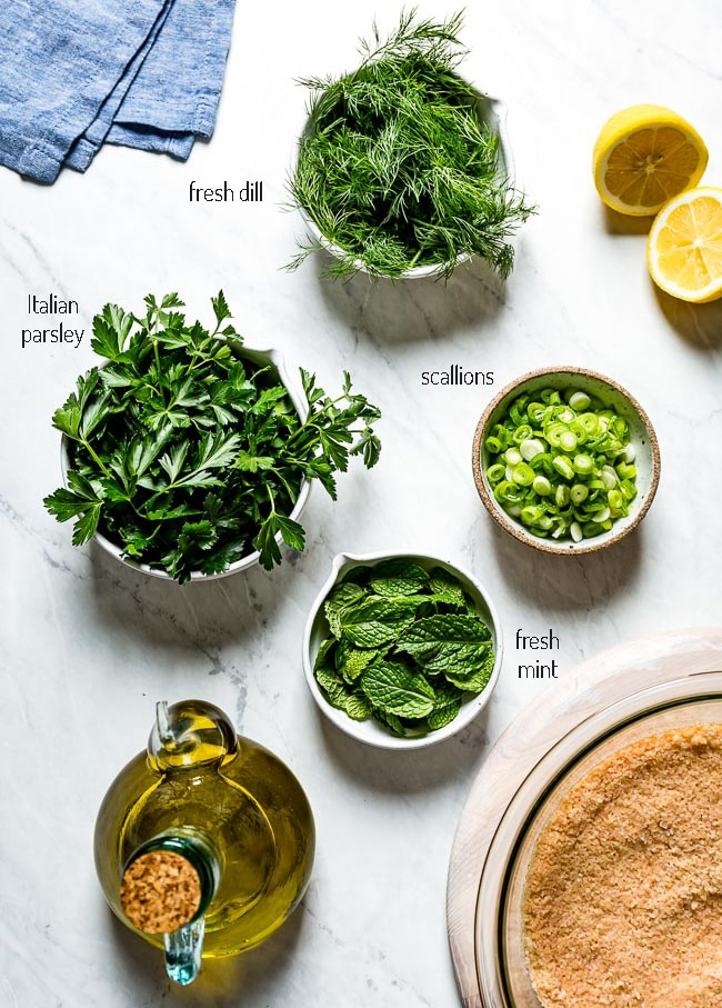 Ingredients for the salad including Fresh herbs and scallion with fresh lemon