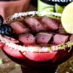 Blueberry Margarita garnished with lime and blueberries