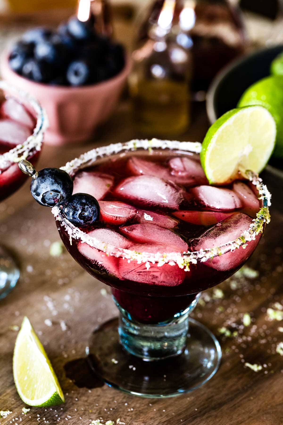 Blueberry Margarita garnished with blueberries and lime