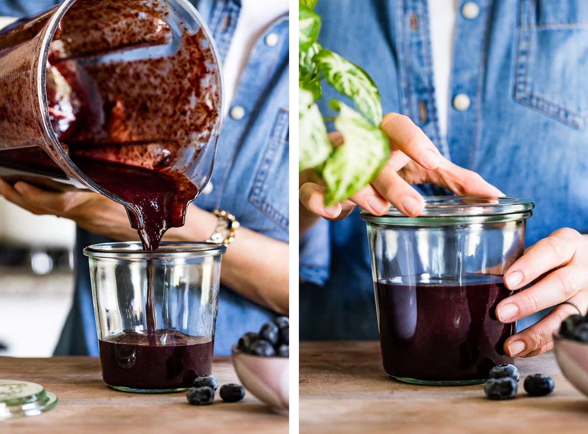 person pouring blueberry puree sauce in a jar and putting a lid on it