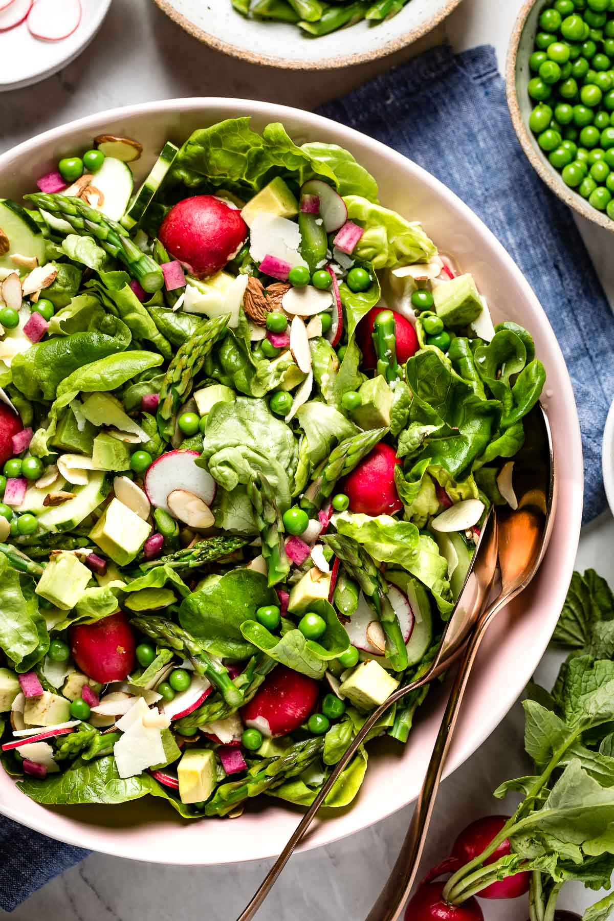 Boston Lettuce Salad in a bowl with some of the salad ingredients around it.