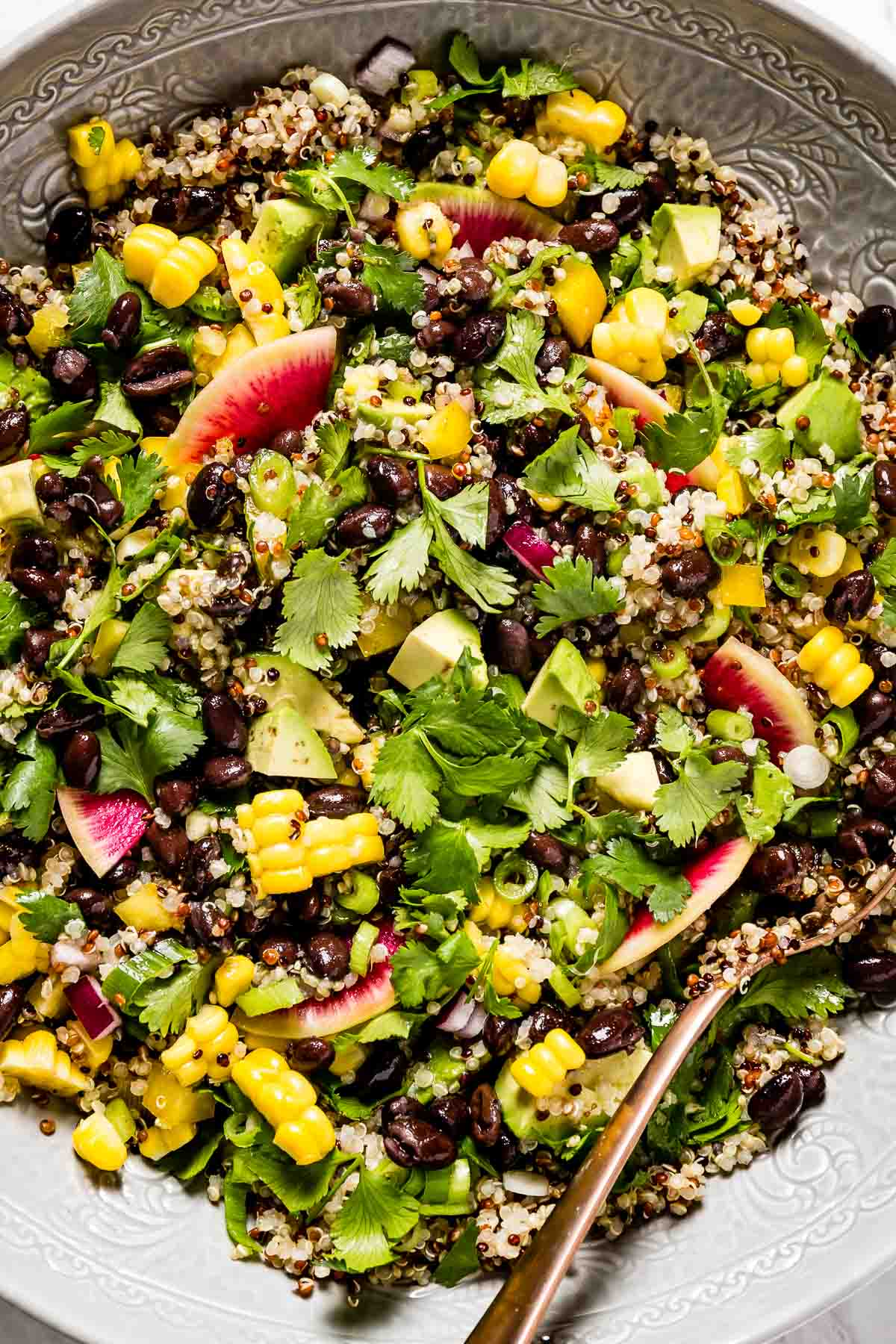 Quinoa Black Bean Avocado Salad in a bowl from close up