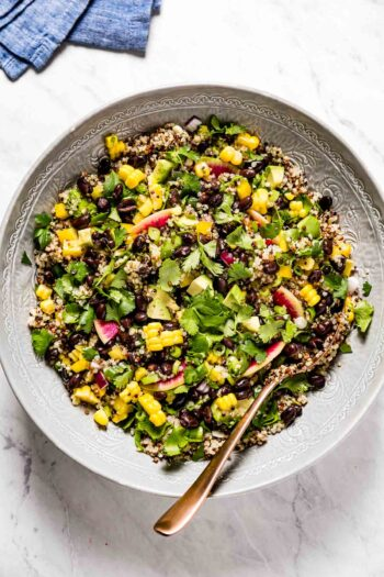 Quinoa Black Bean Salad in a bowl with a spoon