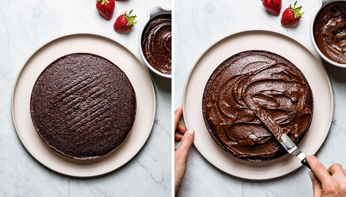 Person spreading cake with chocolate frosting